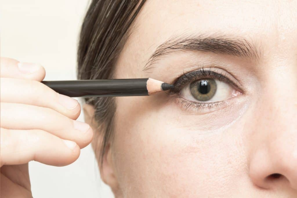 middle aged woman applying eyeliner makeup. 6 Of The Best Eyeliners For Older Women