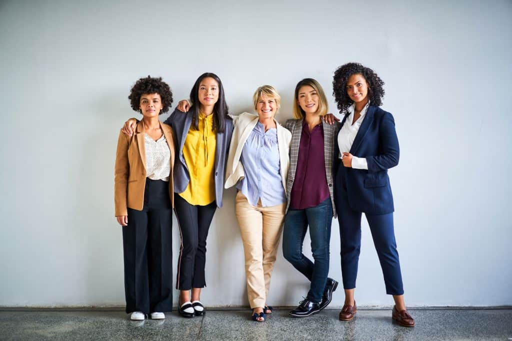A group of woman wearing office attires inside their office