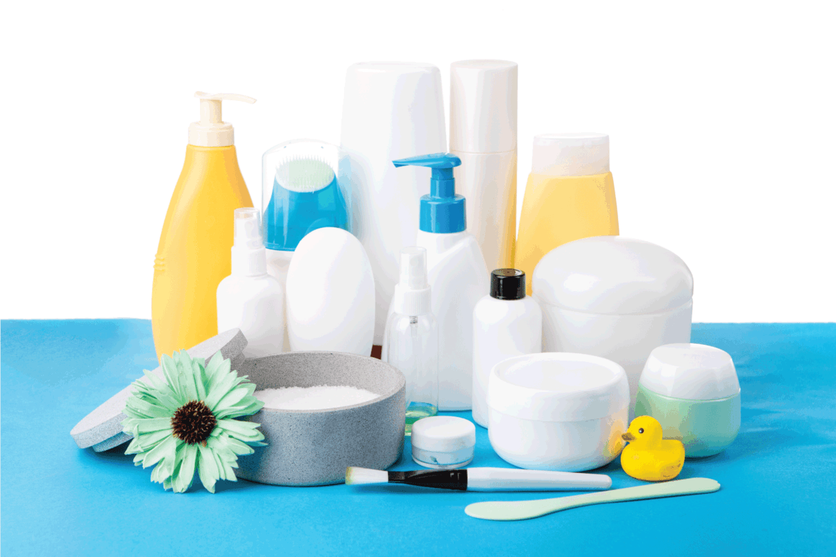 A lot of different cosmetic products for personal care on blue table
