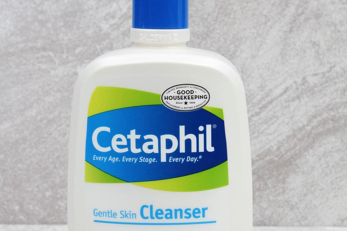 A plastic dispenser bottle of Cetaphil gentle skin cleanser. Cetaphil is a soap free cleanser for sensitive skin, How To Use Cetaphil Skin Cleansers