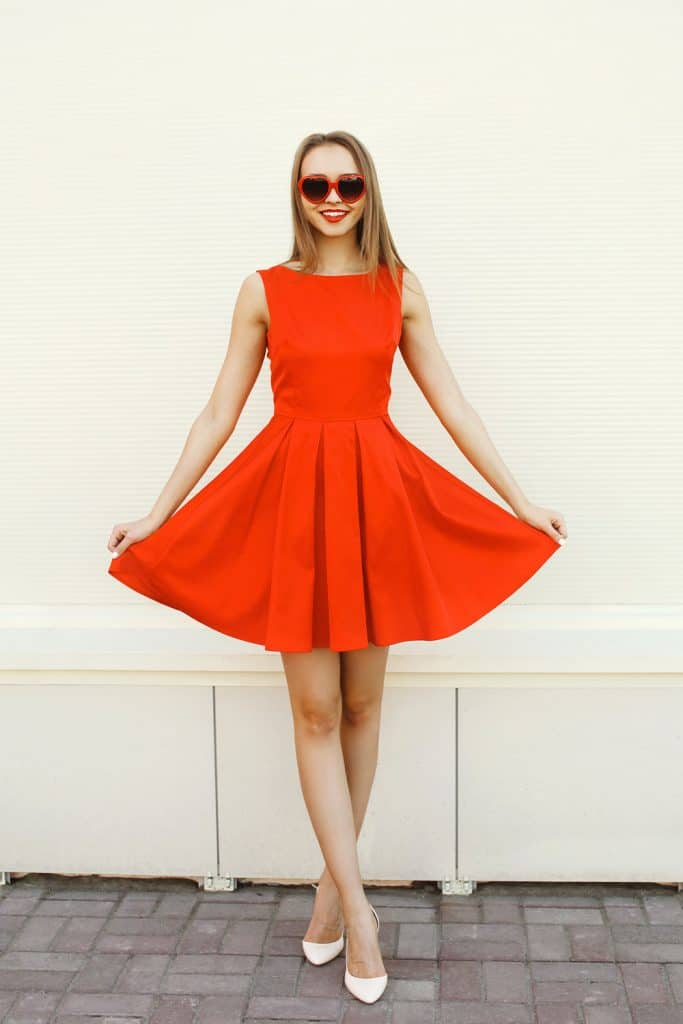 A tall beautiful woman wearing a gorgeous red dress, What Color Shoes Go With A Red Dress?