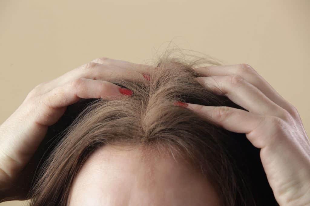 A woman scratching her hair