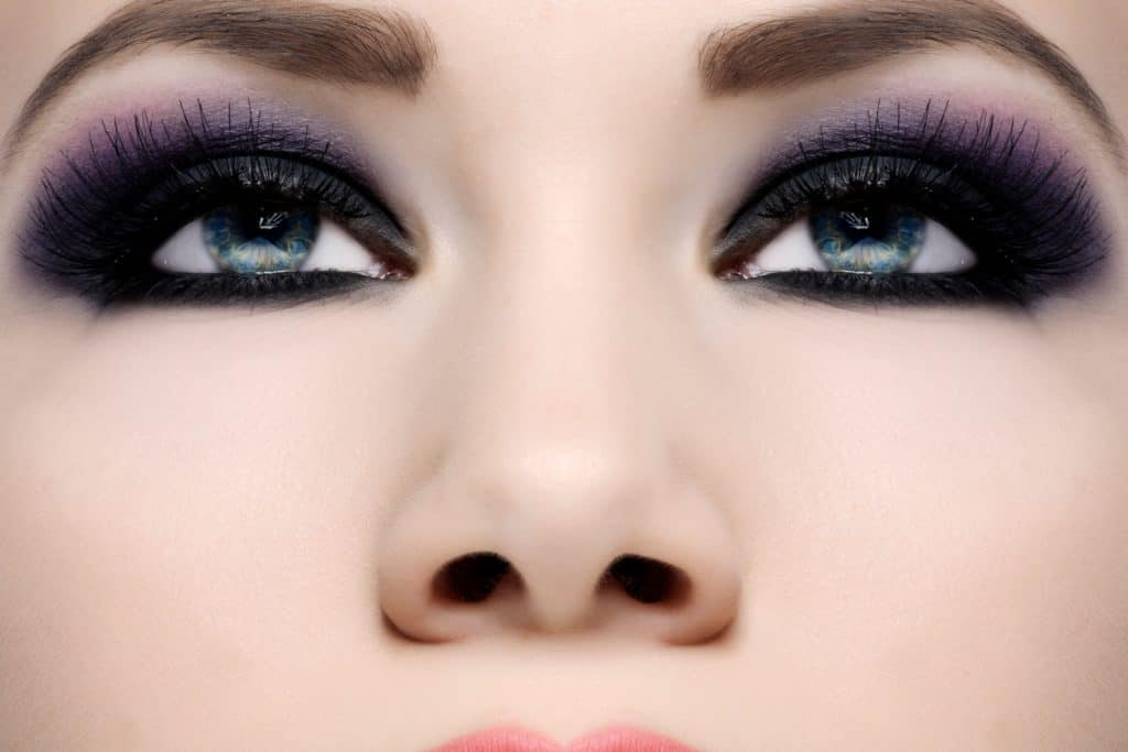 An up close photo of a woman's purples eyelashes