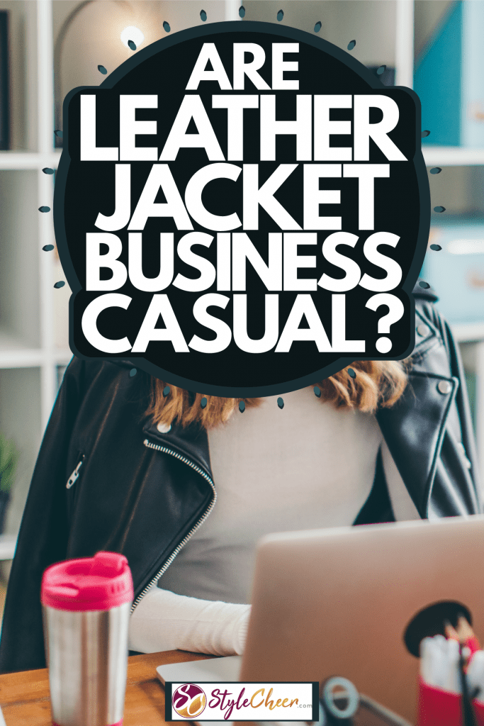 A woman covering herself with a leather jacket while working in her office, Are Leather Jackets Business Casual?