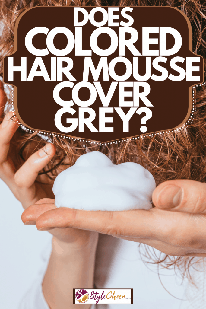 A woman putting hair mousse on her curly blonde hair, Does Colored Hair Mousse Cover Grey?