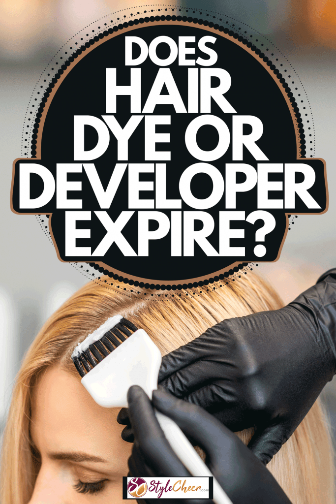 A blonde woman putting on hair dye on her hair at a salon, Does Hair Dye Or Developer Expire?
