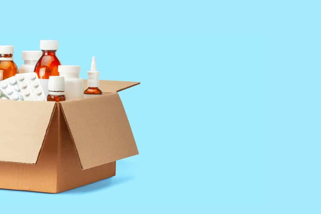 Face care products inside a cardboard box on a blue background