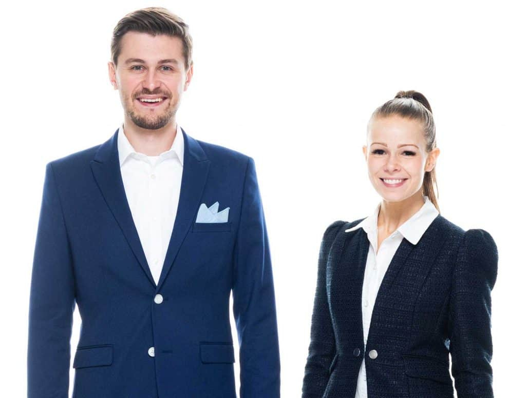 Front view of a young caucasian businessman and businesswoman wearing business casual attire