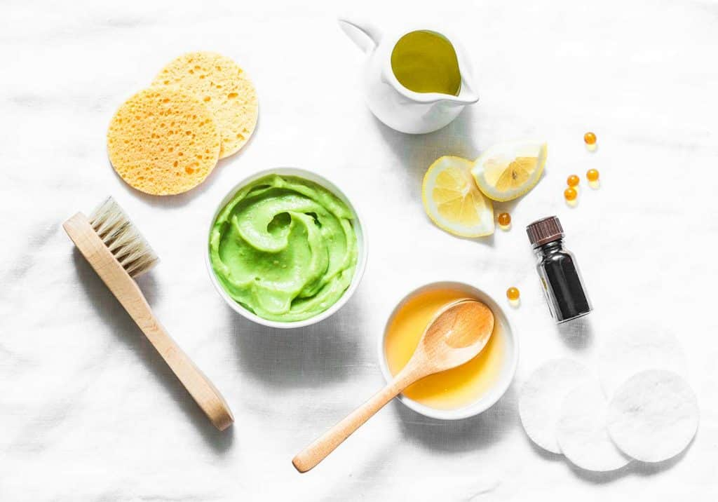 Honey and avocado face mask on light background