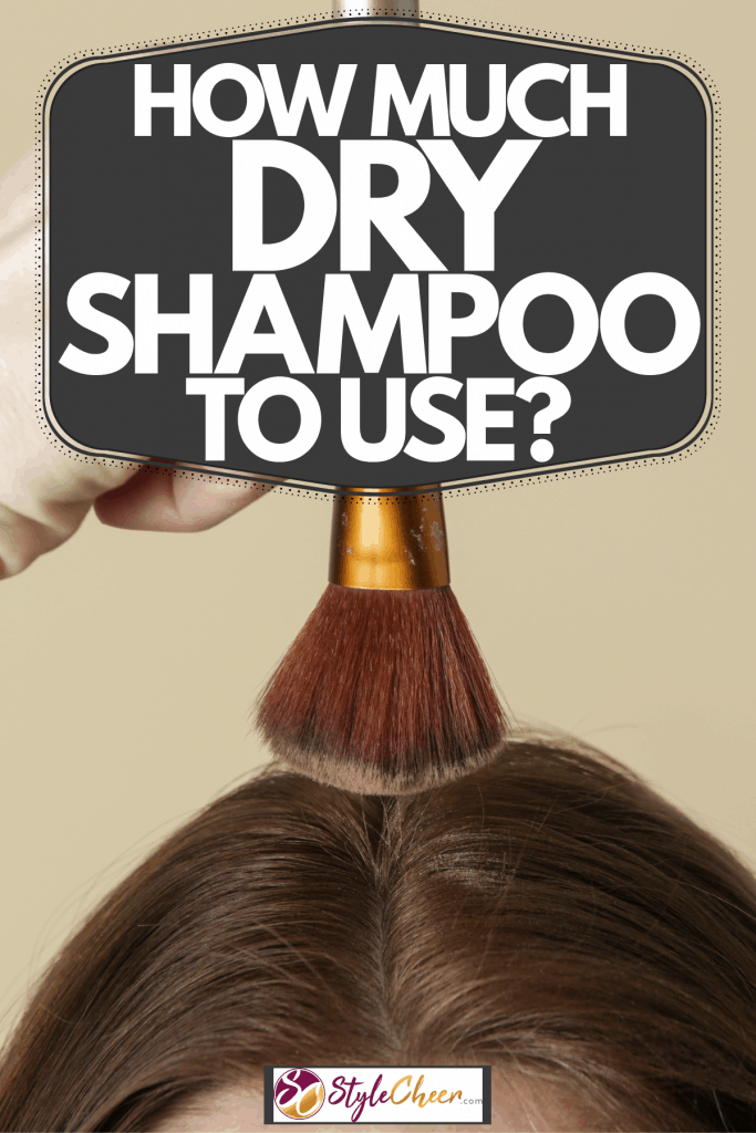 A woman putting on dry shampoo on her hair on a light beige background, How Much Dry Shampoo To Use?