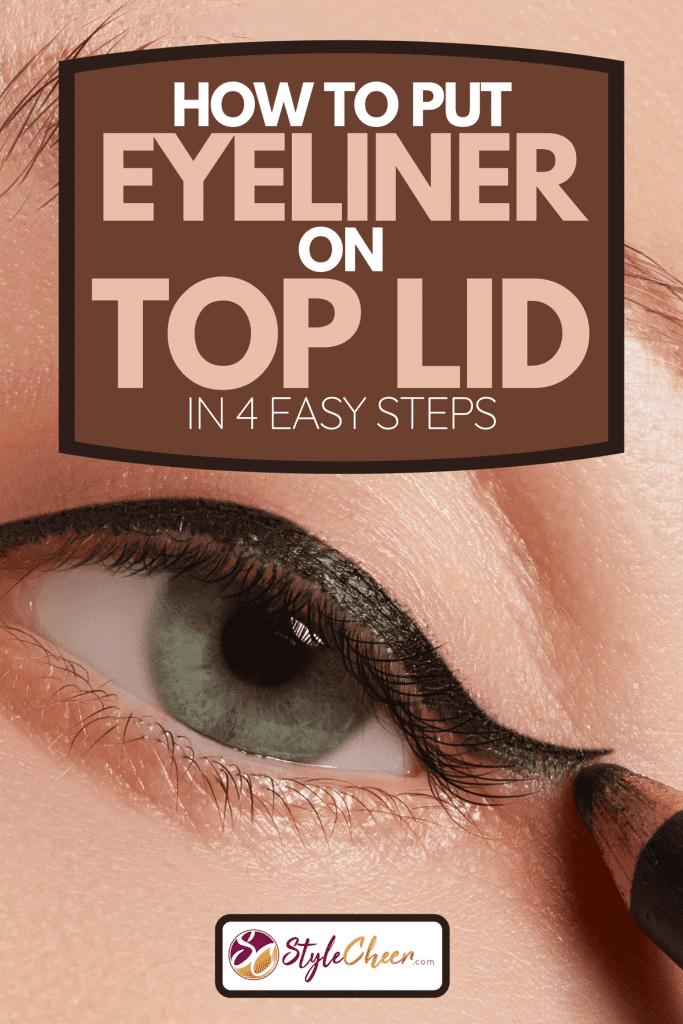 A beautiful model applying eyeliner on top lid, How To Put Eyeliner On Top Lid In 4 Easy Steps