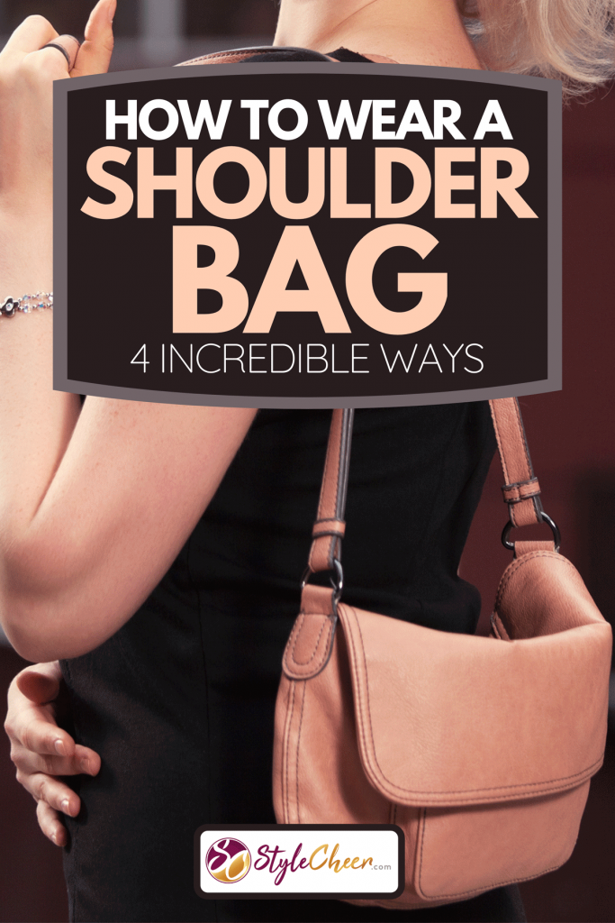 A fashion blond woman in black dress walking on city street, How To Wear A Shoulder Bag [4 Incredible Ways]