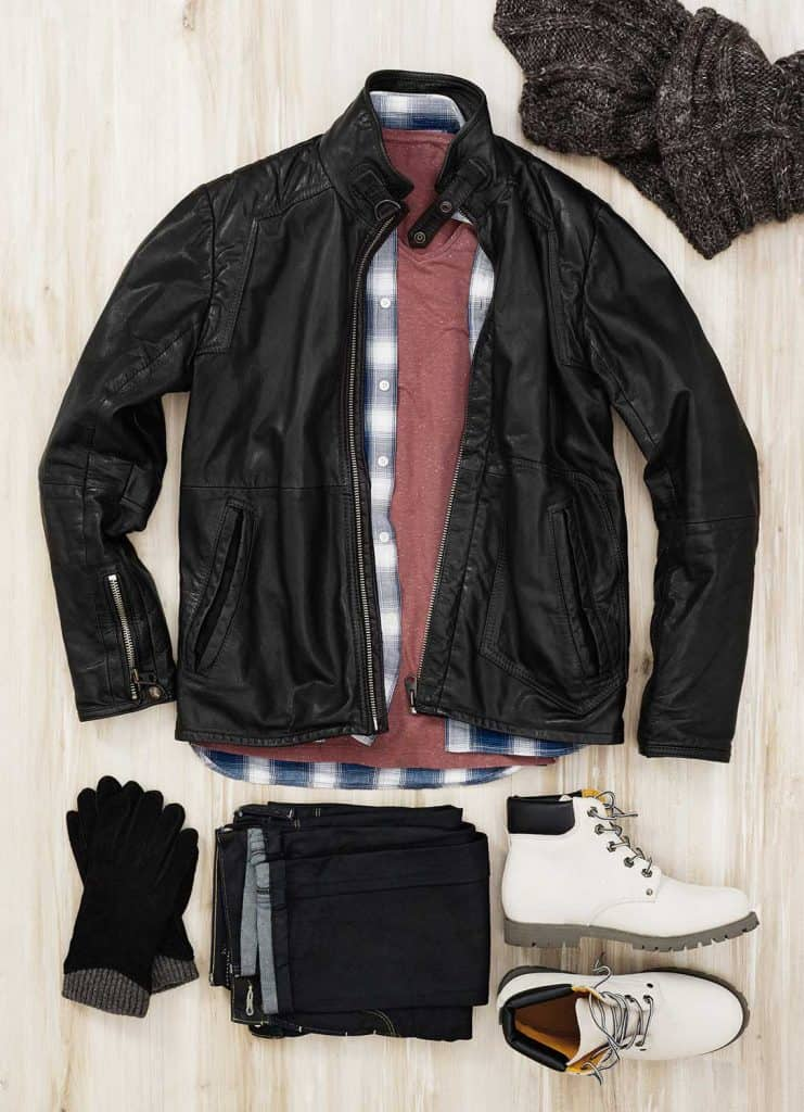 Leather jacket and autumn accessories on wood