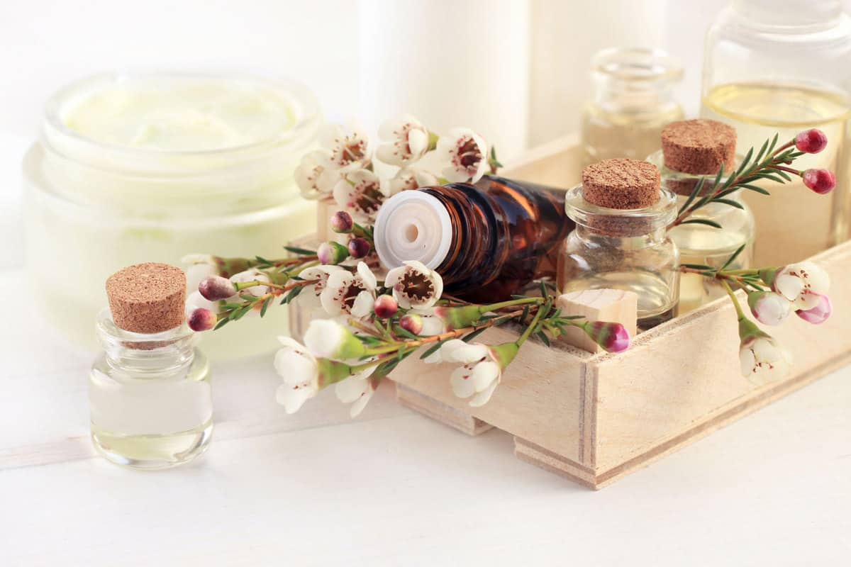 Little apothecary glass vials with aroma essential oil in wooden box, 8 Great Moisturizer Alternatives [And Some That You Shouldn't Use]