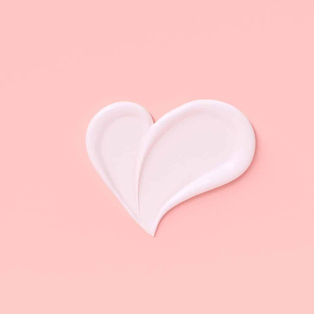 Love girly background. Cosmetic cream pastel pink and white template banner with heart shape smear