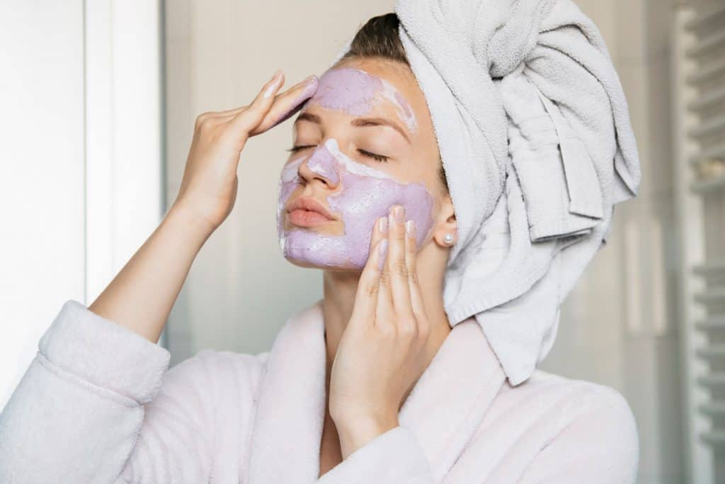 Portrait of young beautiful woman with a facial mask having a spa treatment at home, Do Clay Masks Absorb Oil And Do They Clean Pores?