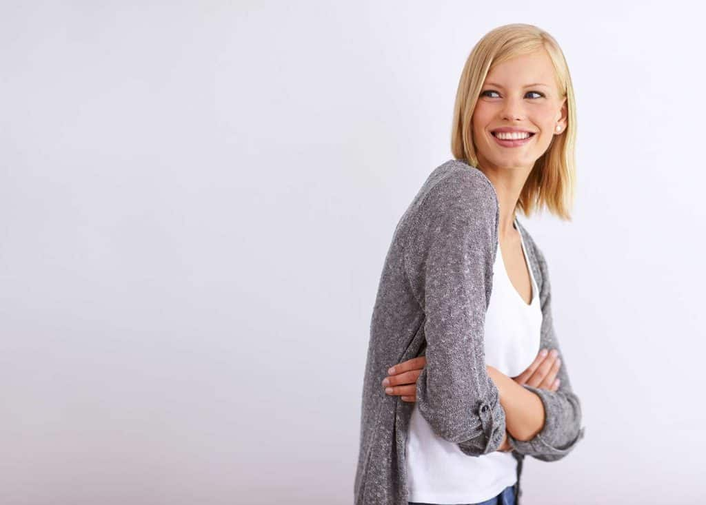Shot of a young woman standing with her arms folded and smiling