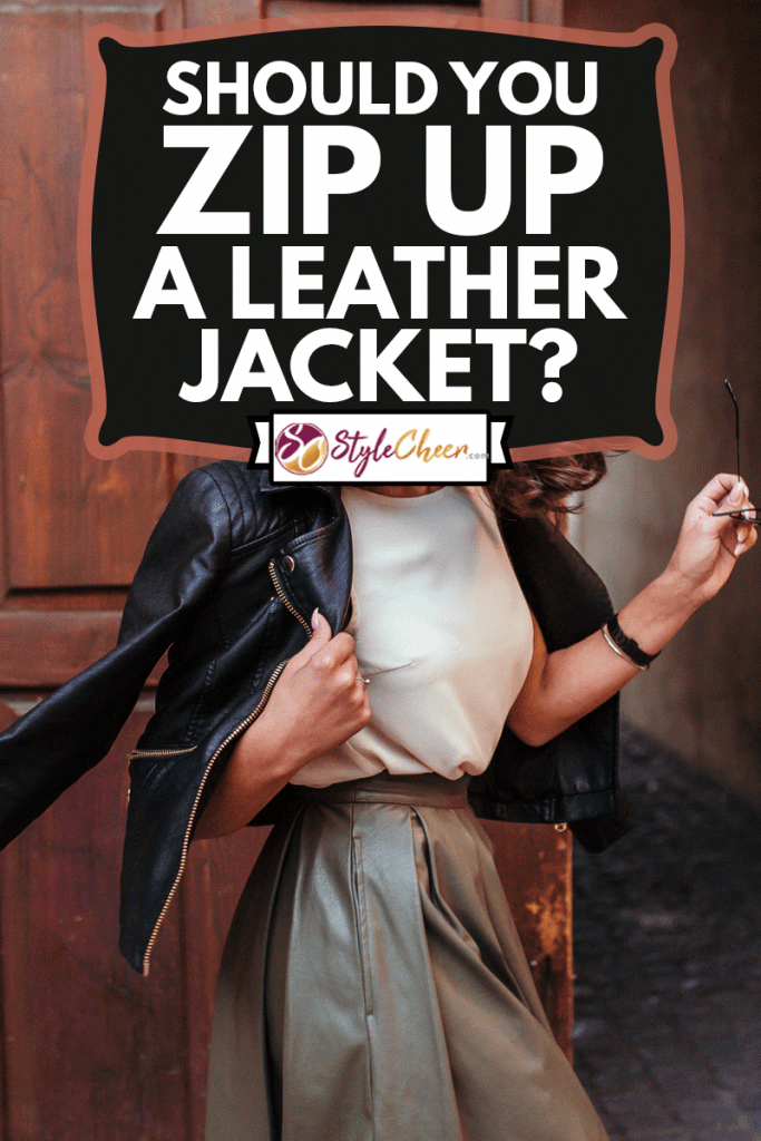 Young pretty fashioned girl wearing skirt and a leather jacket, Should You Zip Up A Leather Jacket?
