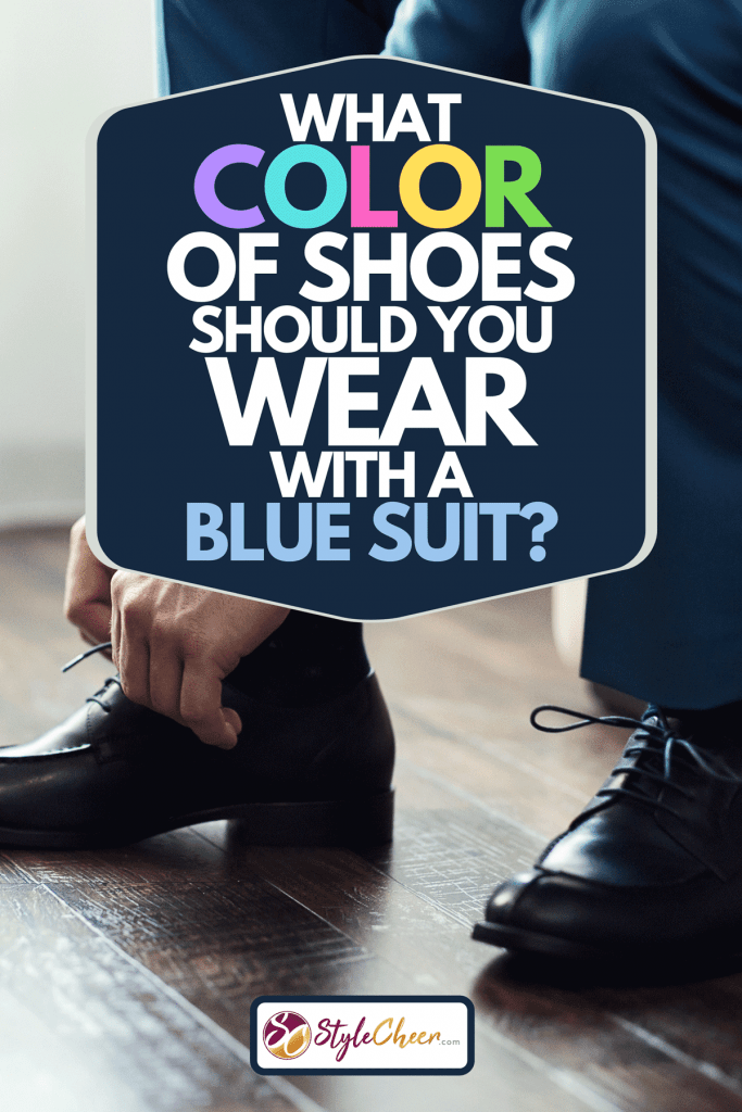 Businessman in suit tying his black leather shoes, What Color Of Shoes Should You Wear With A Blue Suit?