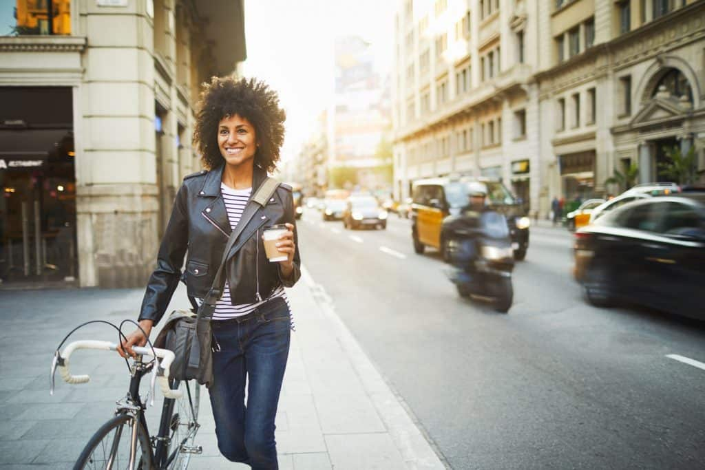 Young hipster woman in the streets wearing leather jacket