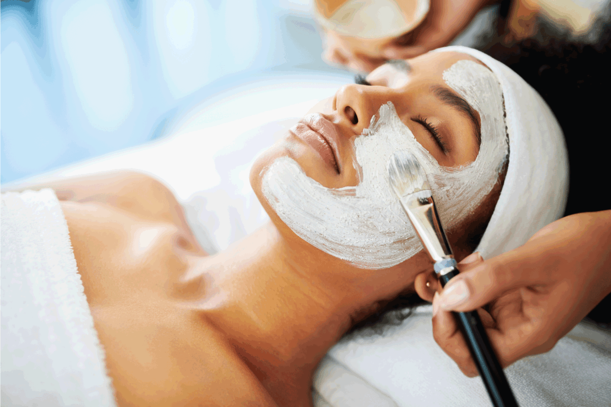 attractive young woman getting a facial at a beauty spa