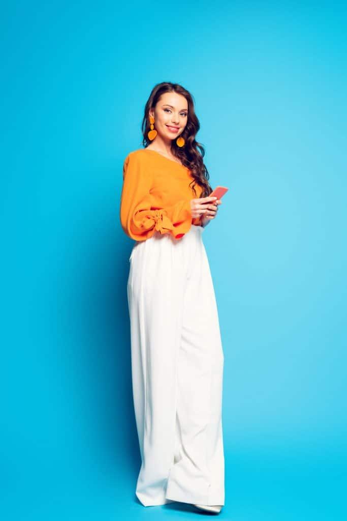 A beautiful woman wearing a yellow dress and white palazzo pant