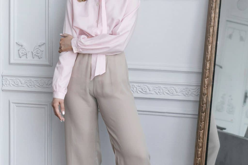 A beautiful woman wearing light pink top and an off white colored palazzo pant, Are Palazzo Pants Business Casual? Are They Appropriate For The Office?
