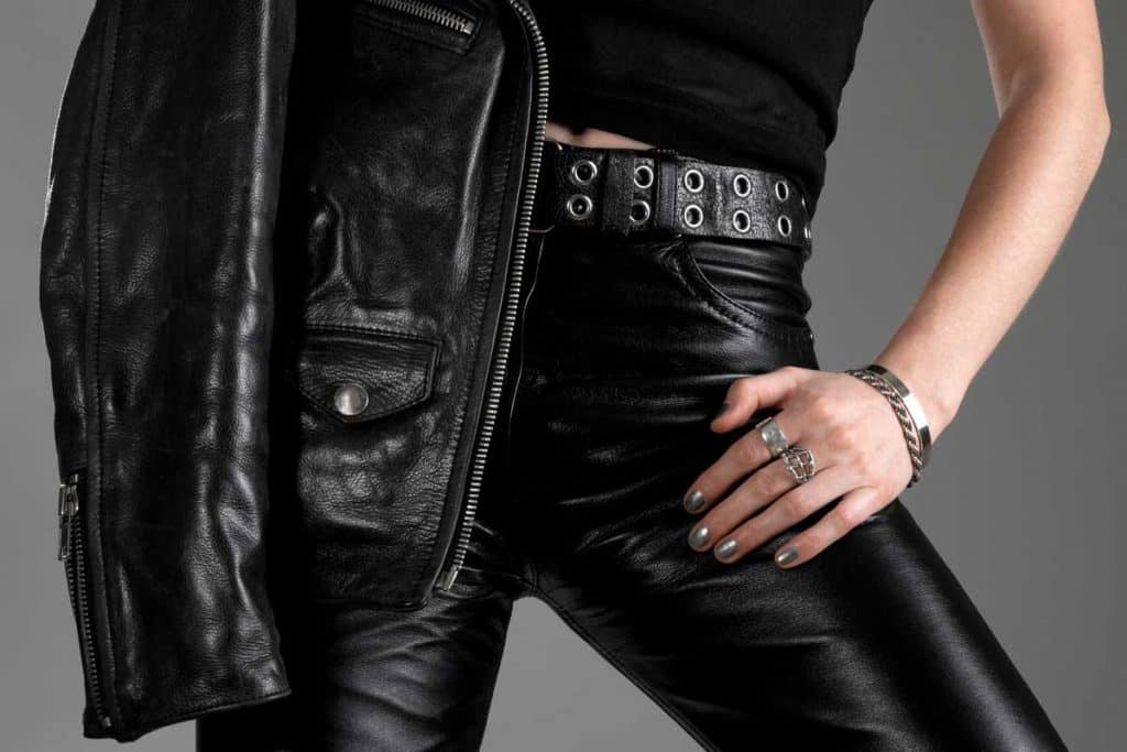 Person wearing black leather pants and jacket, What Pants To Wear With A Leather Jacket