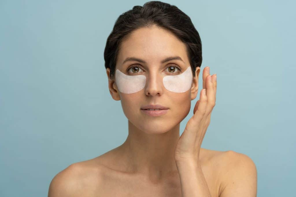 A woman applying gel mask below the eyes,14 Types of Gel Masks And Patches For Face And Eyes