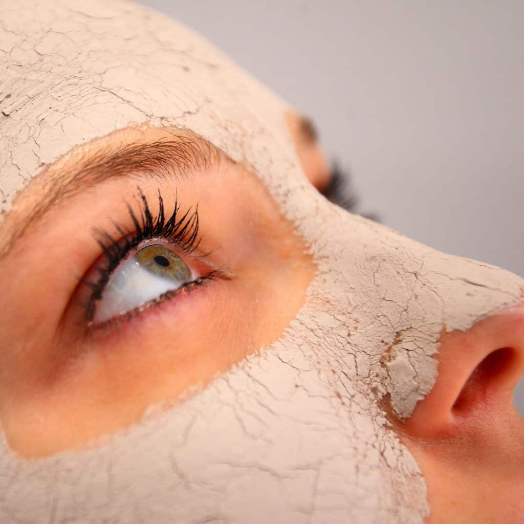 A detailed photo of a woman showing her mud face treatment