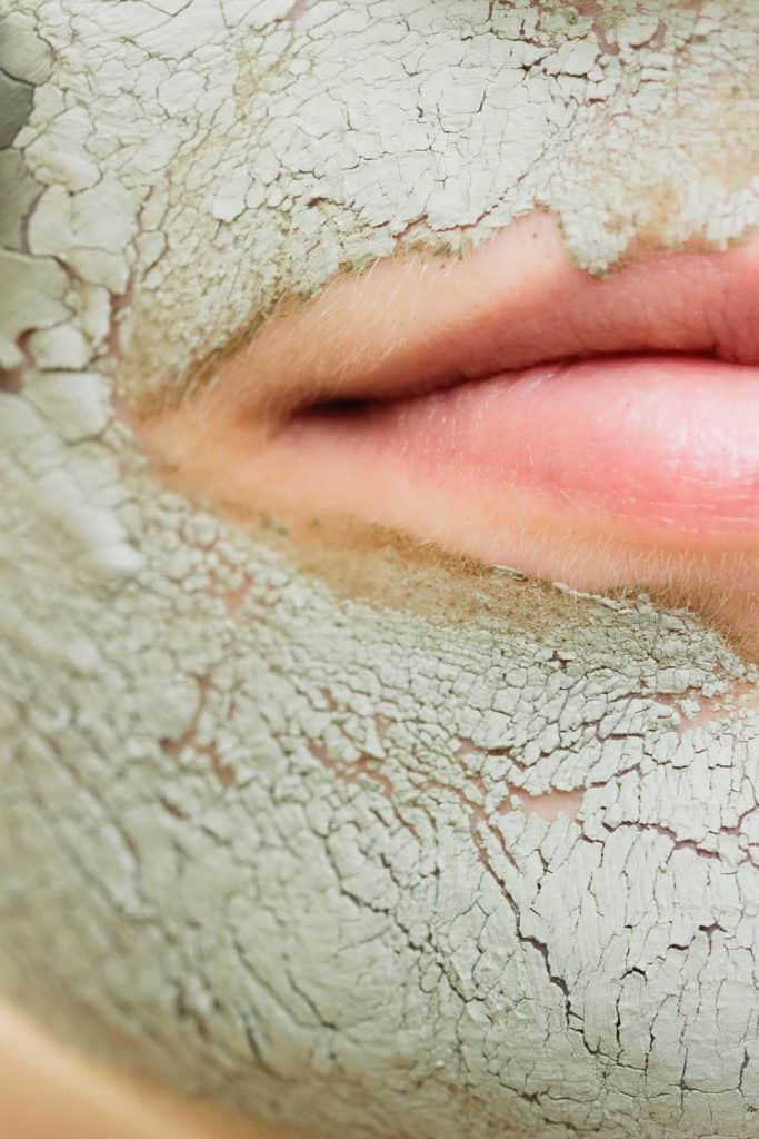 An up close photo of cracking mud facial skin care