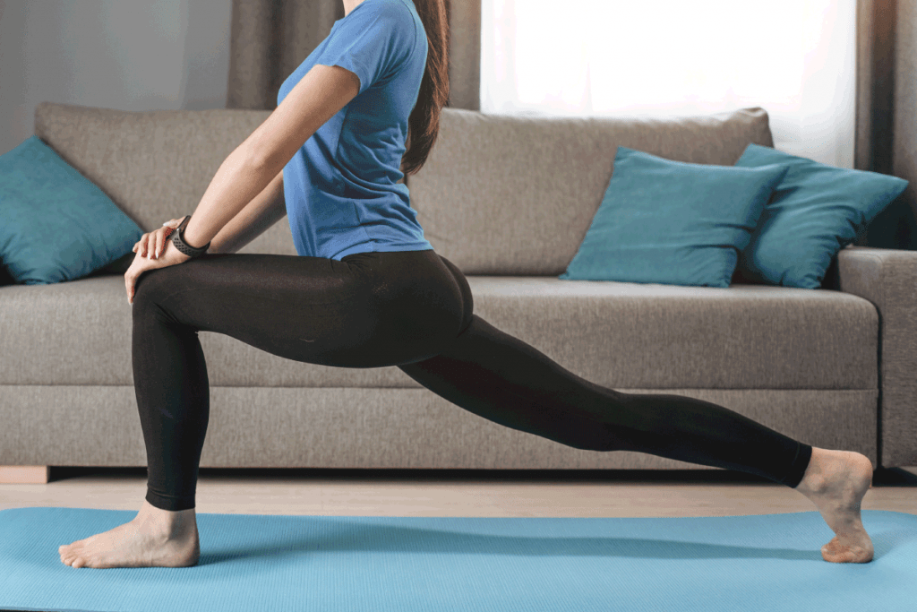Barefooted Brunette in Stretching Pose. How To Fix A Hole In Yoga Pants [A Complete Guide]
