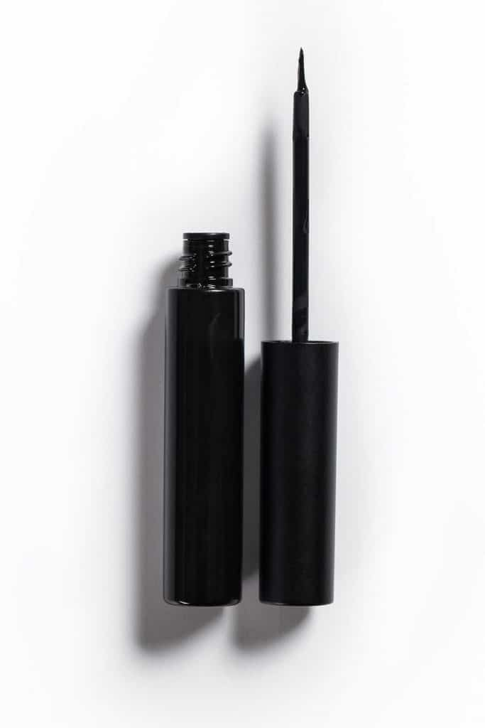 Black cosmetic eyeliner with path and shadow