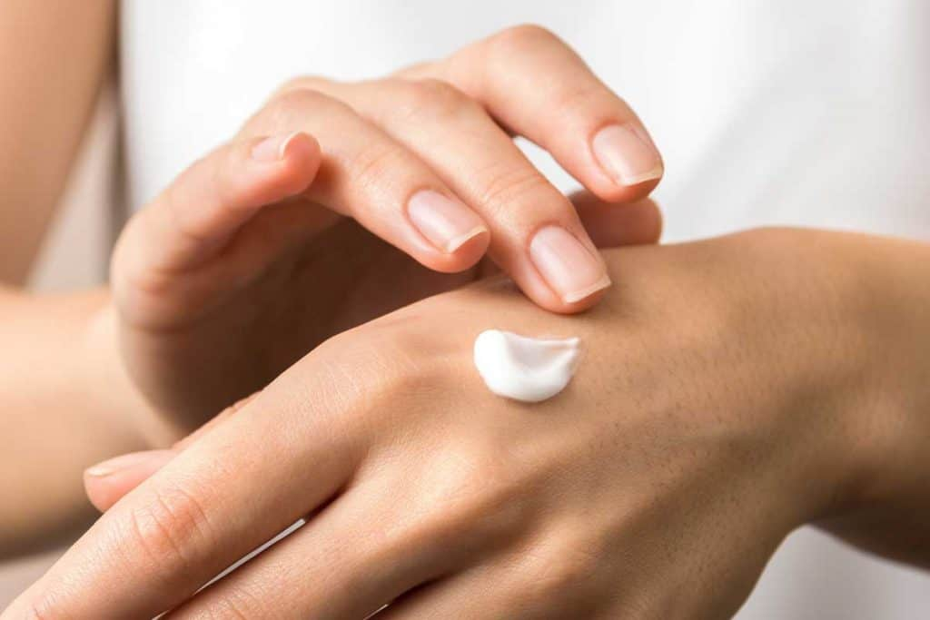 Close up view of woman hand moisturizing them with cream, Can I Use A Face Mask On My Body?