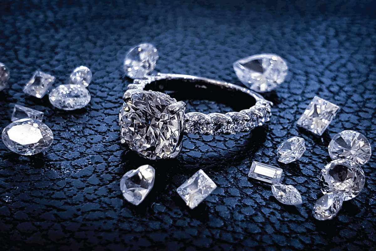 Diamond engagement ring with various different cut gemstones