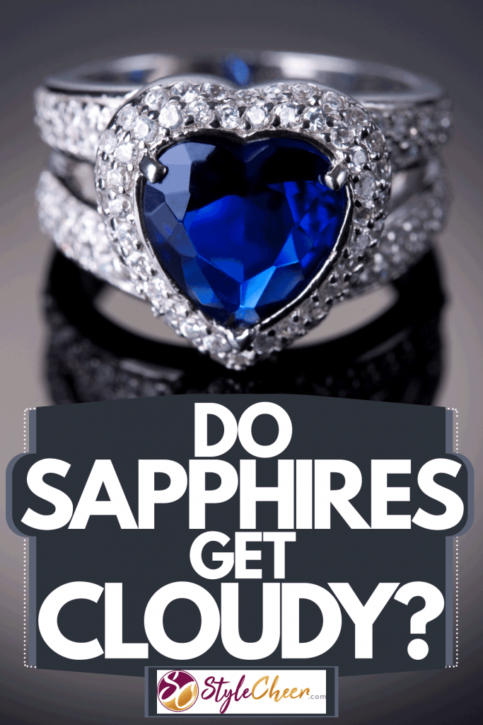 A blue sapphire cut precisely and cut into a diamond with embedded diamonds on the frame, Do Sapphires Get Cloudy?