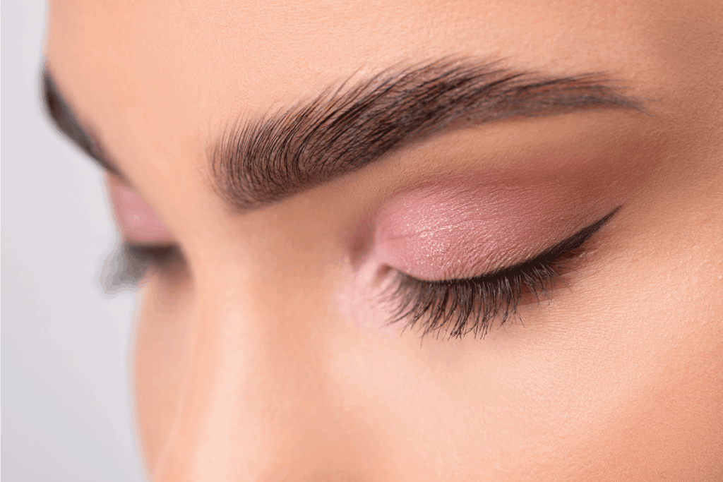 Eyes and eyebrows close up. Portrait of a beautiful teenage girl with beautiful makeup and healthy clean skin. Can Electrolysis Be Done On Eyebrows