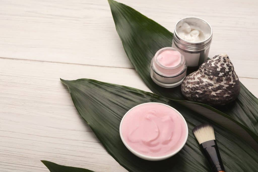 Face mask with lavender essential oil and spa products on white wooden background with green leaves, How Long Do Clay Masks Last?