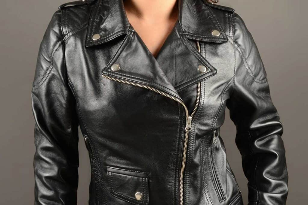 Fashionable young woman wearing bikers leather jacket isolated on gray background, How Much Does A Leather Jacket Weigh?