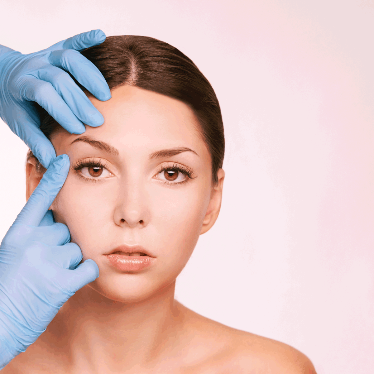 Female derma rejuvenate treatment. Doctor in gloves touch woman face