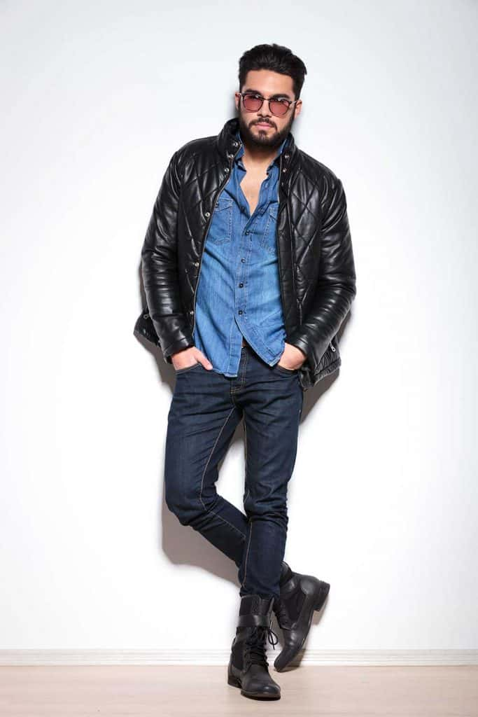 Full body picture of a casual man in leather jacket
