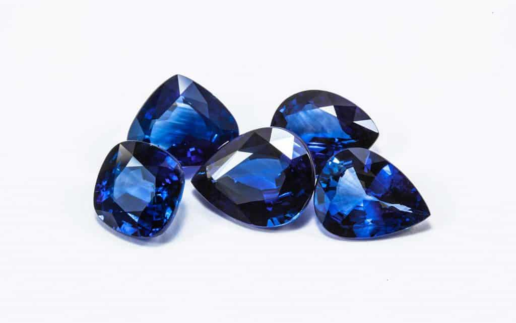 Group of the blue sapphires on white background