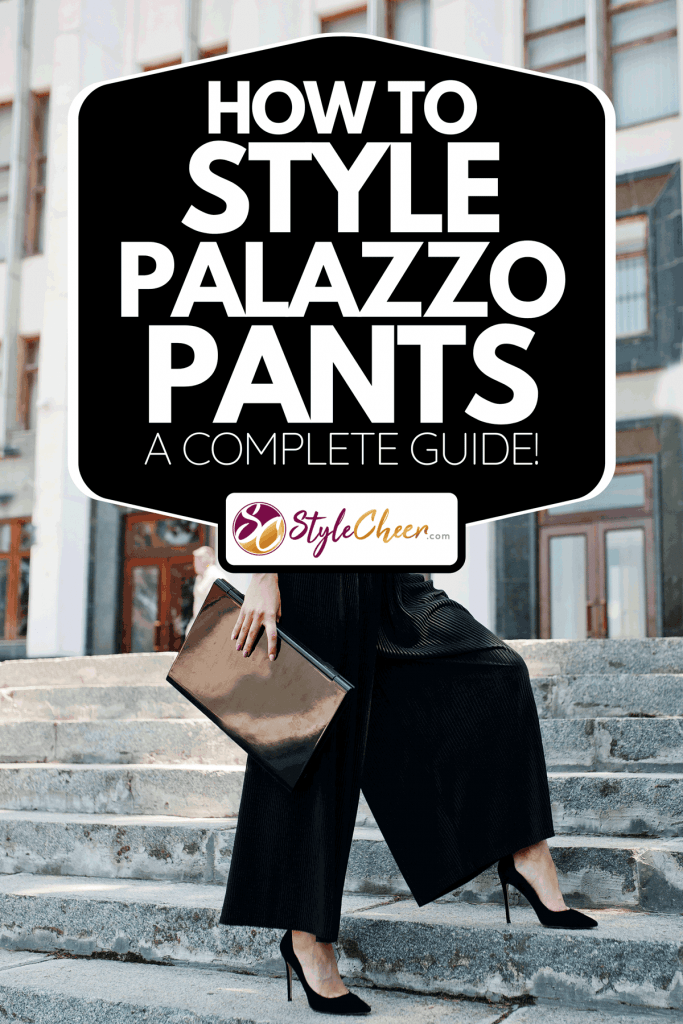 A woman in wide black pants and classic high heels posing on the stairs, How To Style Palazzo Pants [A Complete Guide!]