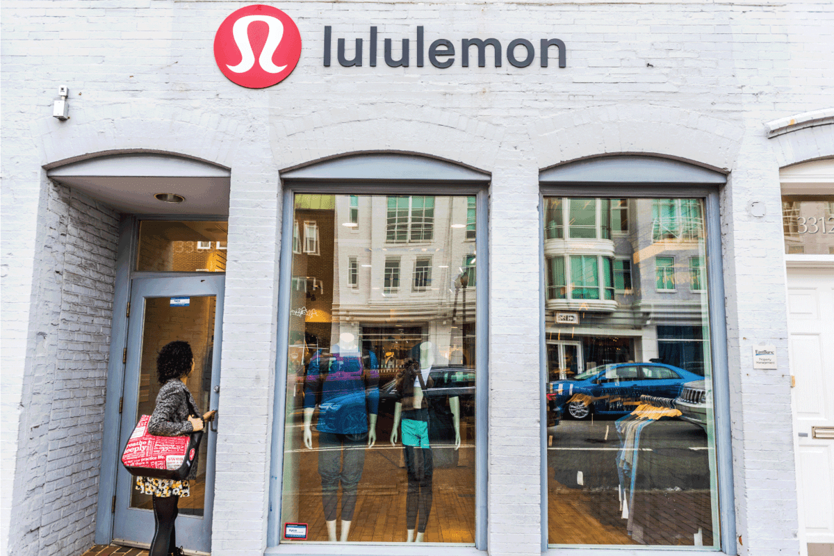 Lululemon building exterior with woman entering store by sign