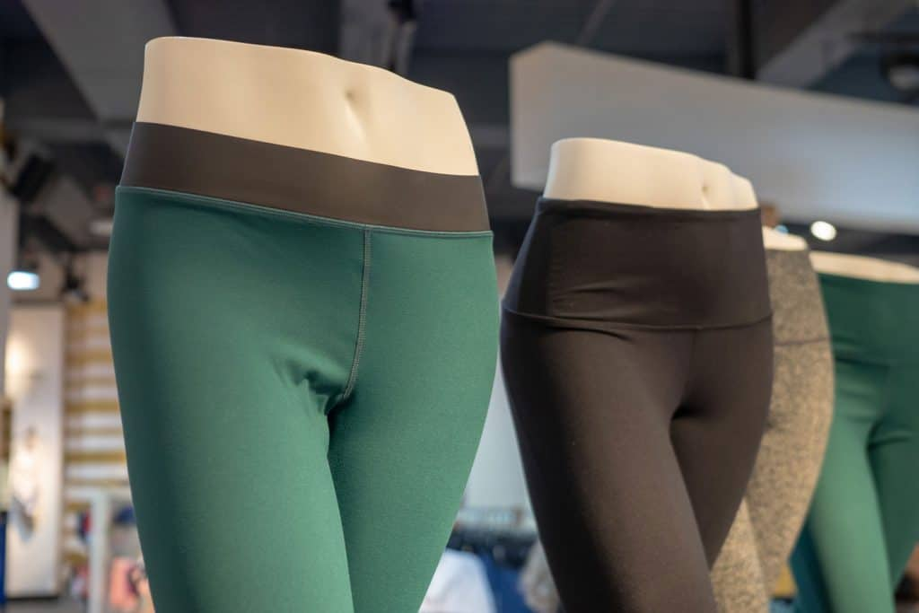 Plastic athletic mannequin lower bodies posing with yoga pants in a store