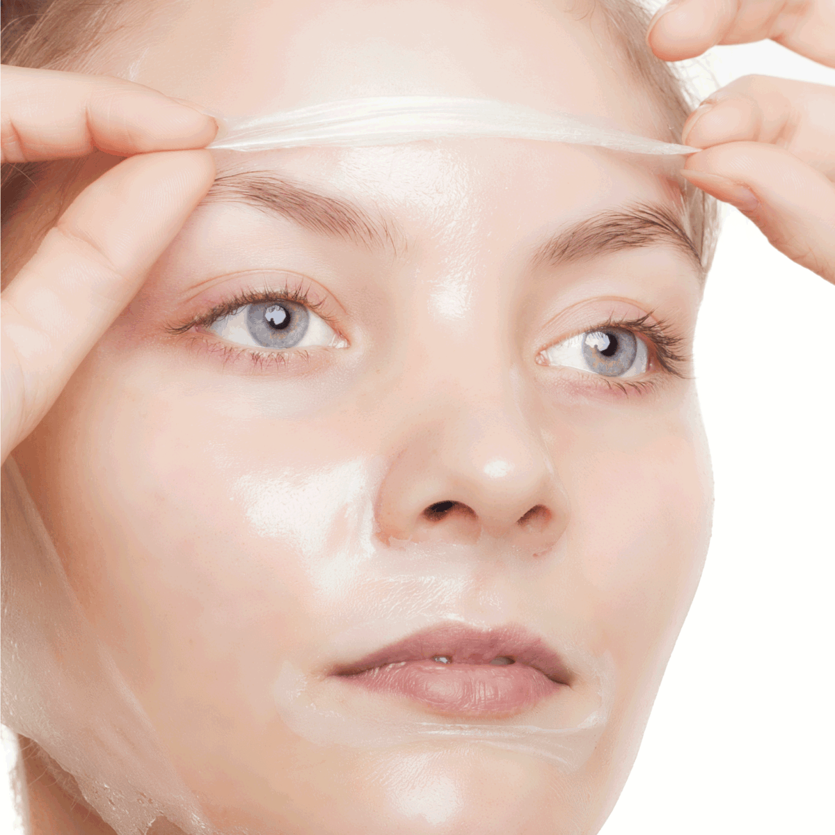 Portrait of girl young woman in facial peel off mask