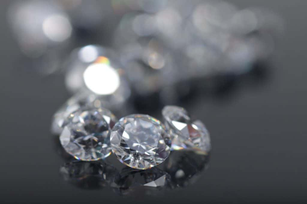 Precisely cut brilliant crystal zirconia perfect for jewelry on a gray background
