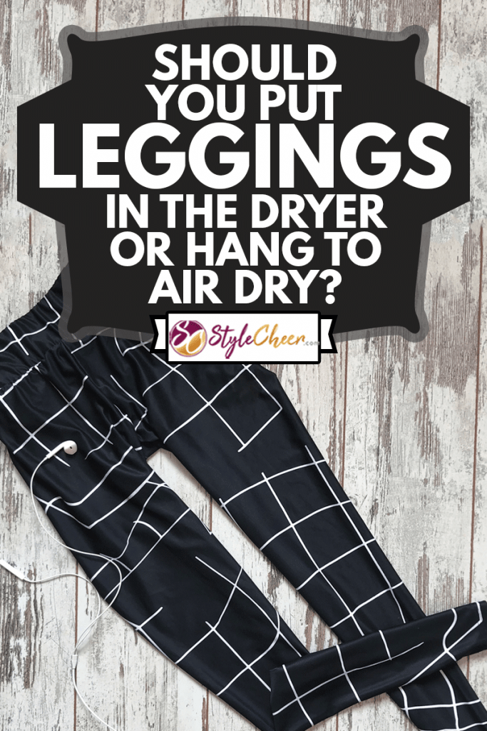 Sporting leggings on a wooden background, Should You Put Leggings In The Dryer Or Hang To Air Dry?