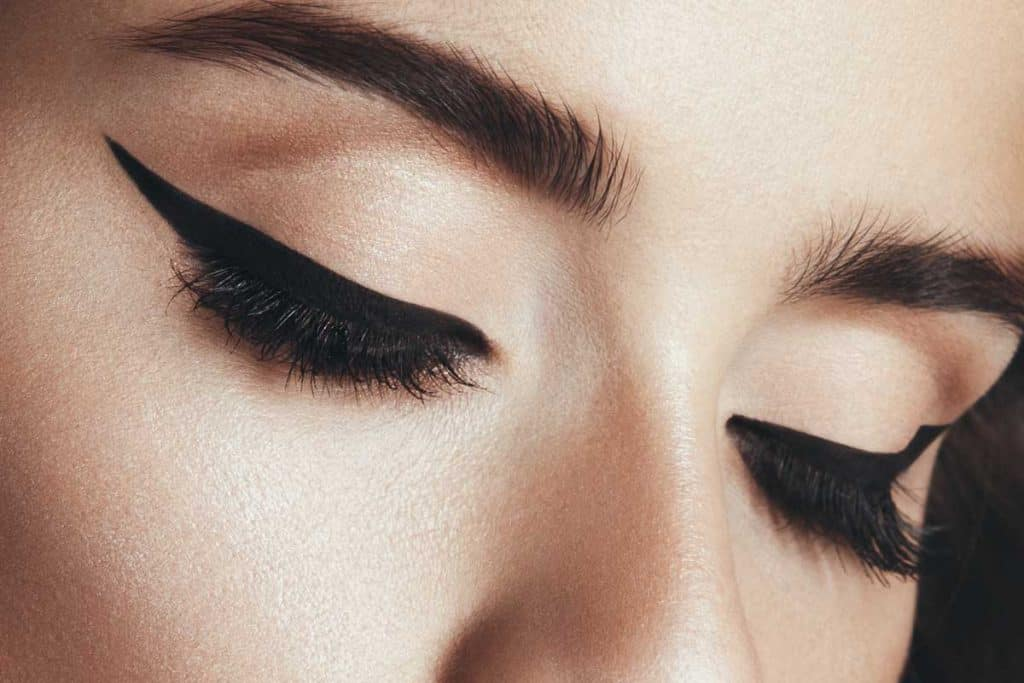 Studio portrait of beautiful woman with professional cat-eye make up, Should Eyeliner Be Thick Or Thin?[A Complete Guide]