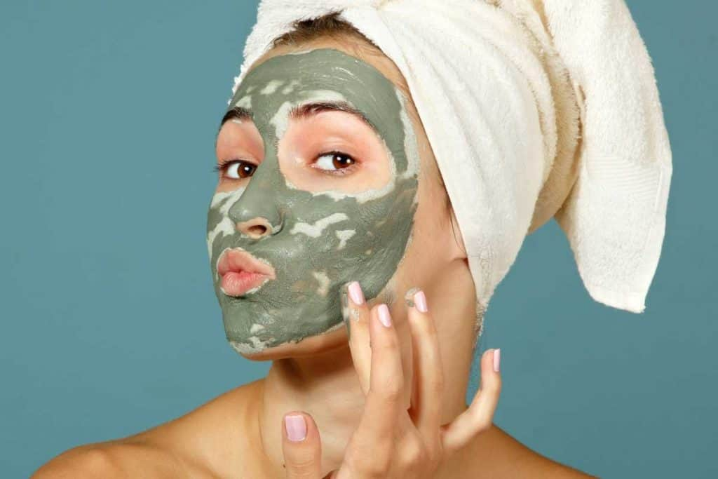 Teen girl applying facial clay mask, Should You Do A Clay Mask Before Or After A Shower?
